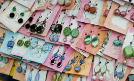 The detail of homemade earrings Stock Images