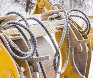 Detail of hoses with dirt and frost of an excavator Stock Photo