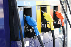 Detail of hoses of petrol pump at a gas station, selective focus Stock Photo