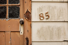 Detail of house number. Close up detail of house number on old abandoned house in Queenstown, Tasmania stock photography