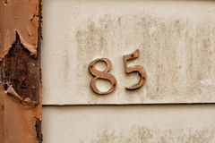 Detail of house number. Close up detail of house number on old abandoned house in Queenstown, Tasmania royalty free stock photo