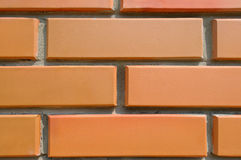 Detail of the house wall. Background of facing bricks Stock Image