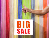 Detail of human hands, to hold,  shop, with a white bag,  on background colored blinds.   big sale sign Stock Images