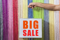Detail of human hands, to hold, shop, with a white bag,  on background colored blinds. big sale sign Stock Photo