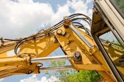Detail of hydraulic bulldozer piston. Excavator arm construction machinery Royalty Free Stock Image