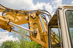Detail of hydraulic bulldozer piston. Excavator arm construction machinery Stock Photography