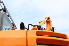 Detail of hydraulic bulldozer sky background Royalty Free Stock Photo