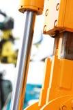 Detail of hydraulic bulldozer white background Royalty Free Stock Image