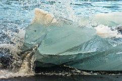 Detail of ice melting in ocean waves,Jokulsarlon glacier lagoon Stock Photography