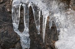 A detail of ice on the walls of a mountain. Ice is the state in which the water stays when it is at low temperature and gives it the solid consistency Royalty Free Stock Images