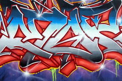 Detail of illegal graffiti painted on public wall - Vandalism Stock Images