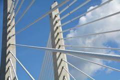 Tilikum Crossing Supports in Portland, Oregon with blue sky and clouds. This is a detail image of two of Tri-Met`s Tilikum Crossing bridge`s support structure in royalty free stock photos