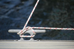 Detail image of yacht rope cleat on sailboat deck Stock Photos