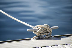 Detail image of yacht rope cleat on sailboat deck stock photography