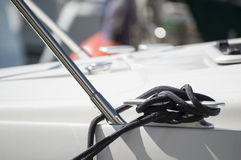 Detail image of yacht rope cleat on sailboat deck Stock Images