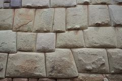 Detail of an Inca wall in Cuzco city, Peru. Hand made wall in the Inca Empire royalty free stock photo