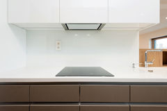 Detail of induction cooker in contemporary kitchen Stock Photos