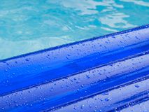 Detail of an inflatable pad  floats  in a swimming pool Royalty Free Stock Photo