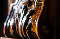 Detail of a inlaid wood furniture. Detail of an oiled inlaid antique wood furniture Royalty Free Stock Photography