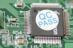 Detail of an integrated circuit. With a sticker of quality control Royalty Free Stock Image