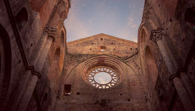 Detail of the interior of San Galgano Abbey, Tuscany. Interior of medieval San Galgano Abbey at the sunset, Tuscany, Italy Royalty Free Stock Images