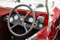 Detail of an interior of a vintage car convertible red. Close-up of an interior of a vintage car convertible red royalty free stock images