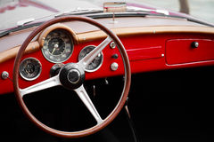 Detail of an interior of a vintage red car convertible. Close up of an interior of a vintage red car convertible Stock Image