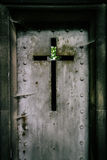 Detail of an iron mausoleum iron door in a cemetery. Royalty Free Stock Image