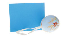 Detail of isolated blue wish card and Easter egg stock photography