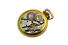 Detail of an isolated golden pocket watch. Deatail of a inner mechanism of a steel and golden pocket watch stock images