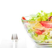 Detail of italian fresh salad with fork on white Stock Image