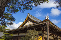 Detail on japanese temple roof against blue sky Stock Image