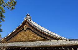 Detail on japanese temple roof against blue sky Stock Photography