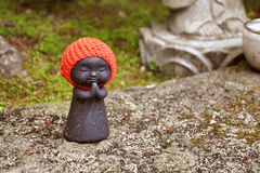 Detail of a Jizo statue in a Japanese temple royalty free stock images