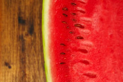 Detail of juicy watermelon on wooden table Stock Photography