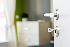 Detail of the key in the door with beautiful modern bedroom Stock Images
