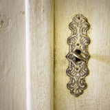 Detail of the key of an old Italian furniture royalty free stock image
