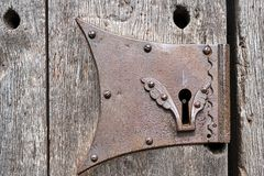 Detail of a keyhole. Of an old wooden door royalty free stock image