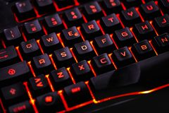 Detail of a Qwerty keyboard. Detail of the keys of a backlit qwerty keyboard for gaming computers stock images