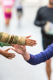 Detail of kids doing high fives and motivates the runners Royalty Free Stock Images