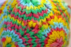 Coloful detail of a knitted yarn polygon figure. Detail of a knitted colorful yarn polygon Stock Photo