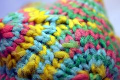 Coloful knitted yarn polygon figure detail. Detail of a knitted colorful yarn polygon Royalty Free Stock Images