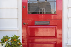 Detail of lacquered red front door to a home Royalty Free Stock Photo