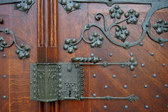 Detail of large entrance door of the Catholic Church of Gau-Alge Royalty Free Stock Photo