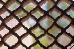 Detail of a lattice from holes. With harmonious shapes with blurred background royalty free stock photo