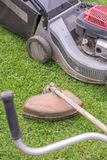 Lawnmower and brushcutter for lawn care royalty free stock photo