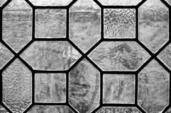 Detail of leaded glass window. In black and white stock image