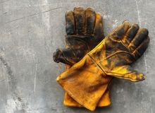 Leather glove after work hard on dirty cement ground Stock Image