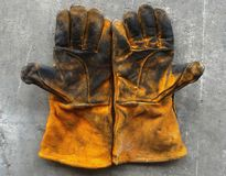 Leather glove after work hard on dirty cement ground Royalty Free Stock Image