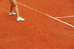 Detail of the legs of a tennis woman Royalty Free Stock Photos
